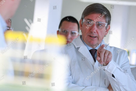 Belgian Finance Minister Johan Van Overtveldt looks at a laboratory assistant displaying the fuel analysis process during the inauguration of the new building of the Customs and Excise Laboratory of the FPS Finance in Vilvoorde, Belgium, 13 November 2018. All beers marketed in Belgium are first analysed in the new laboratory to measure the original extract of beer and thus be able to determine excise duties. Fuel samples are also analysed to verify that no fraud is committed.