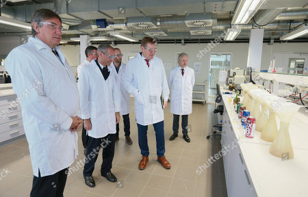 Belgian Interior Minister Jan Jambon (L) and Belgian Finance Minister Johan Van Overtveldt (2-R) observe the beer analysis process during the inauguration of the new building of the Customs and Excise Laboratory of the FPS Finance in Vilvoorde, Belgium, 13 November 2018. All beers marketed in Belgium are first analysed in the new laboratory to measure the original extract of beer and thus be able to determine excise duties. Fuel samples are also analysed to verify that no fraud is committed.