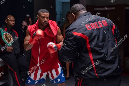 Corey Calliet as Creed Cornerman and Michael B. Jordan as Adonis Creed