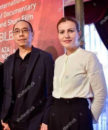 Thai film maker Apichatpong Weerasethakul (L) poses with the director of the Zinebi, Vanesa Fernandez (R), before receiving the Zinebi International Documentary and Short Film Festival's Mikaldi Honour Award, in Bilbao, Basque Country, northern Spain, 14 November 2018. The festival takes place from 09 to 16 November.