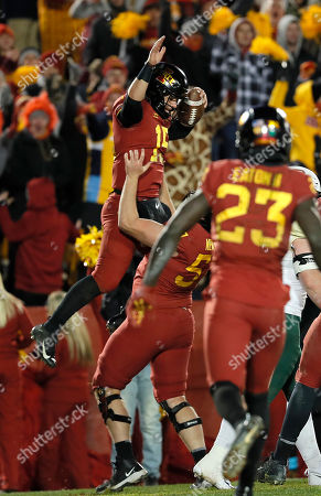 Brock Purdy, Colin Newell. Iowa State quarterback Brock Purdy, top, celebrates a touchdown with offensive lineman Colin Newell, bottom, during the second half of an NCAA college football game, in Ames. Iowa State won 28-14