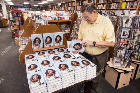 Stock Picture of Barry Cutler of Washington, DC, picks up a copy of the book 'Becoming' by former US First Lady Michelle Obama, to purchase for his wife at Politics and Prose Bookstore in Washington, DC, USA, 13 November 2018. The new memoir by Michelle Obama has a global publication date of 13 November.