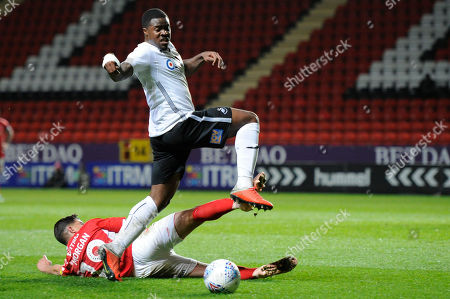 Albie Morgan of Charlton Athletic and Tyler Reid of Swansea City u21 in action during the Checkatrade Trophy group stage match between Chartlton Athletic at The Valley in London, UK - 13th November 2018