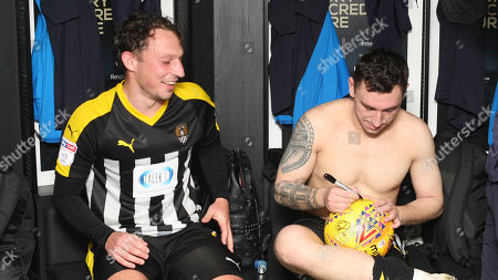 Nathan Thomas signs Kristian Dennis' hat-trick ball after the match