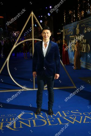 Rick Yune poses for photographers upon arrival at the premiere of the film 'Fantastic Beasts: The Crimes of Grindelwald', at a central London cinema