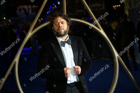 Dan Fogler poses for photographers upon arrival at the premiere of the film 'Fantastic Beasts: The Crimes of Grindelwald', at a central London cinema