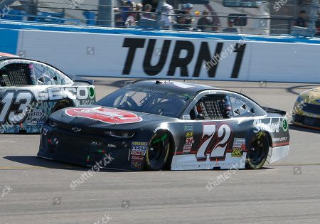 Stock Photo of Cole Whitt (72) during a NASCAR Cup Series auto race, in Avondale, Ariz