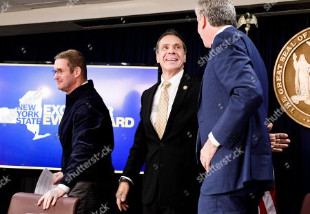 John Schoettler (L), Amazon's Vice President for Global Real Estate and Facilities, New York Governor Andrew Cuomo (C) and New York City Mayor Bill de Blasio (R) smile following a press conference officially announcing Amazon's decision to open one of two new national headquarters in the Long Island City neighborhood in New York, New York, USA, 13 November 2018. The new headquarters, similar to one also being opened in Crystal City, Virginia, will reportedly have 25,000 jobs.