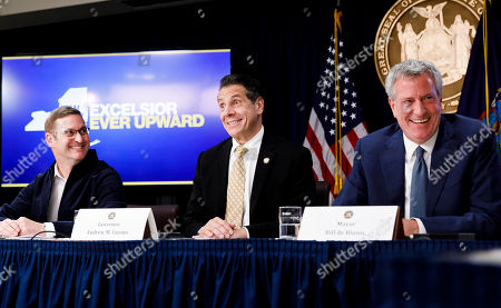 New York Governor Andrew Cuomo (C), John Schoettler (L), Amazon's Vice President for Global Real Estate and Facilities, and New York City Mayor Bill de Blasio (R) talk to reporters during a press conference officially announcing Amazon's decision to open one of two new national headquarters in the Long Island City neighborhood in New York, New York, USA, 13 November 2018. The new headquarters, similar to one also being opened in Crystal City, Virginia, will reportedly have 25,000 jobs.