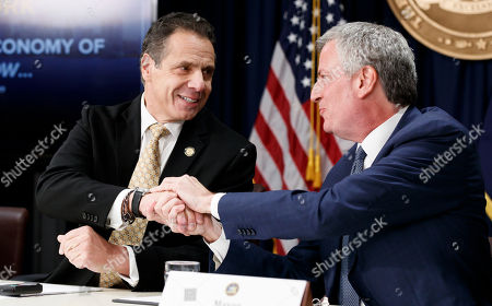 New York Governor Andrew Cuomo (L) and New York City Mayor Bill de Blasio (R) shake hands during a press conference officially announcing Amazon's decision to open one of two new national headquarters in the Long Island City neighborhood in New York, New York, USA, 13 November 2018. The new headquarters, similar to one also being opened in Crystal City, Virginia, will reportedly have 25,000 jobs.