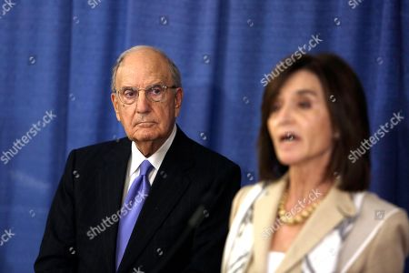 George Mitchell, Chair of the Independent Oversight Committee, listens to administrator Camille Biros during a news conference, in Philadelphia