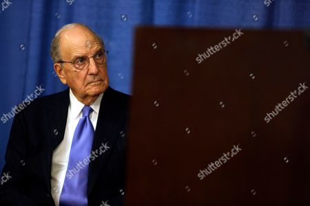 Stock Image of George Mitchell, Chair of the Independent Oversight Committee, listens during a news conference, in Philadelphia