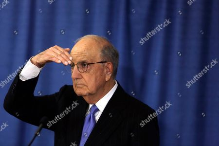 Stock Photo of George Mitchell, Chair of the Independent Oversight Committee, listens to a reporter's question, during a news conference, in Philadelphia
