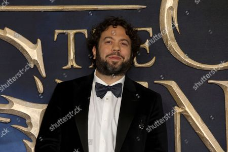 Dan Fogler poses for photographers on arrival at the premiere of the film 'Fantastic Beasts: The Crimes of Grindelwald', in London