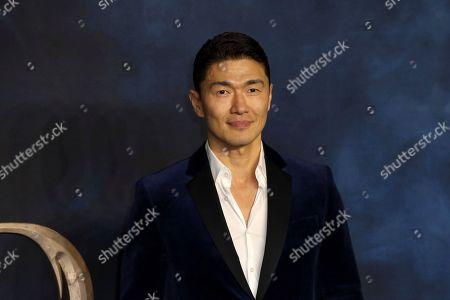 Rick Yune poses for photographers on arrival at the premiere of the film 'Fantastic Beasts: The Crimes of Grindelwald', in London
