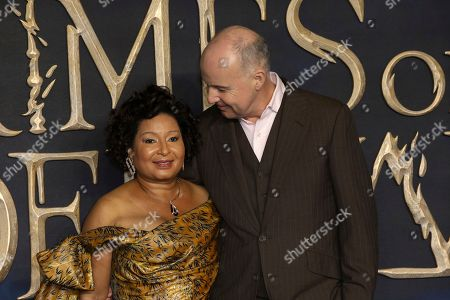 David Yates, Yvonne Walcott. FIlm Director David Yates and partner Yvonne Walcott pose for photographers on arrival at the premiere of the film 'Fantastic Beasts: The Crimes of Grindelwald', in London