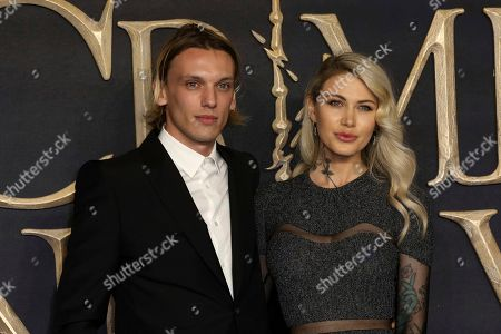 Jamie Campbell Bower, Ruby Quilter. Actor Jamie Campbell Bower and partner Ruby Quilter pose for photographers on arrival at the premiere of the film 'Fantastic Beasts: The Crimes of Grindelwald', in London