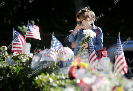 Jan Broughton reacts as she pays her respects at a make-shift memorial for the mass shooting victims from the Borderline Bar & Grill in Thousand Oaks, California, USA, 13 November 2018. A total of 13 people were killed including the gunman who took his own life at the popular night spot on 07 November 2018.