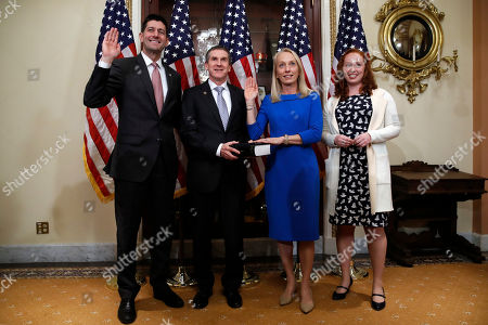 Paul Ryan, Mary Gay Scanlon, Mark Stewart, Casey Stewart. House Speaker Paul Ryan of Wis., left, ceremonially swears-in Rep.-elect Mary Gay Scanlon, D-Pa., second from right, as her husband Mark Stewart holds the Bible, in the speaker's ceremonial office on Capitol Hill in Washington. Scallion will fill a vacancy for the remainder of the 115th Congress. At right is their daughter, Casey Stewart