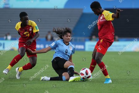 Jacqueline Owusu (R) of Ghana in action against Cecilia Gomez (C) of Uruguay during the Women's Under 17 Wolrd Cup group A match between Uruguay and Ghana, at the Charrua Stadium, in Montevideo, Uruguay, 13 November 2018.