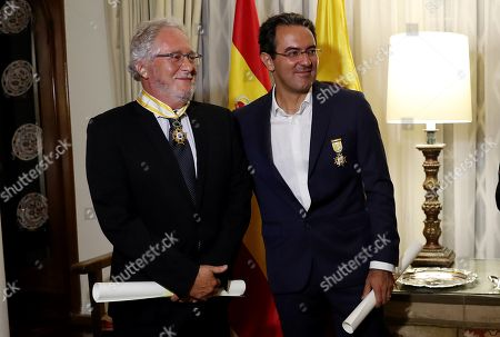 Stock Picture of Colombian writer Hector Abad Faciolince (L) and the Colombian writer Juan Gabriel Vasquez (R) are seen after receive the Order of Isabel la Catolica in the Encomienda Grade and in the Official Cross Grade respectively in Bogota, Colombia, 13 November 2018.