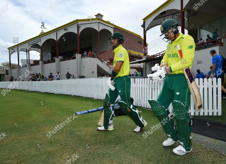 Reeza Hendricks (L) and Quinton de Kock (R) of South Africa are seen walking out to bat during the T20 tour match between the Cricket Australia XI and South Africa played at Allan Border Field in Brisbane, Australia, 14 November 2018.