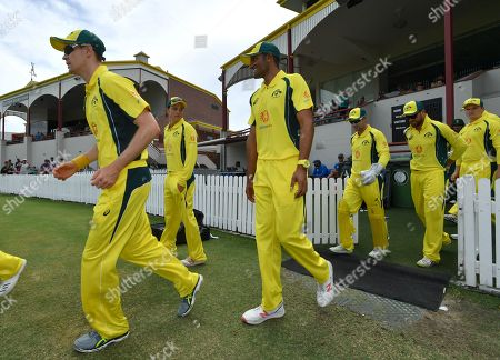 Members of the Cricket Australia XI team take to the field during the T20 tour match between the Cricket Australia XI and South Africa played at Allan Border Field in Brisbane, Australia, 14 November 2018.