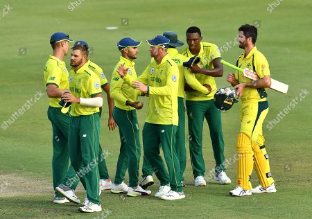 South Africa celebrate winning as Ben Cutting of the Cricket Australia XI (R) looks on during the T20 tour match between the Cricket Australia XI and South Africa played at Allan Border Field in Brisbane, Australia, 14 November 2018.