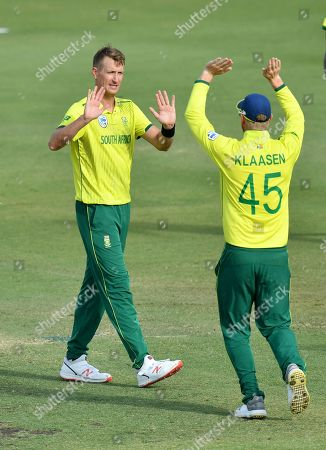 Chris Morris (L) of South Africa celebrates with team mate Heinrich Klaasen (R) after getting the wicket of Kelvin Smith of the Cricket Australia XI during the T20 tour match between the Cricket Australia XI and South Africa played at Allan Border Field in Brisbane, Australia, 14 November 2018.