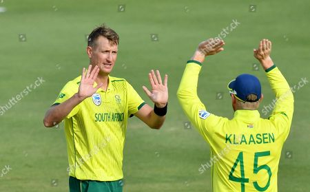 Stock Picture of Chris Morris (L) of South Africa celebrates with team mate Heinrich Klaasen (R) after getting the wicket of Kelvin Smith of the Cricket Australia XI during the T20 tour match between the Cricket Australia XI and South Africa played at Allan Border Field in Brisbane, Australia, 14 November 2018.
