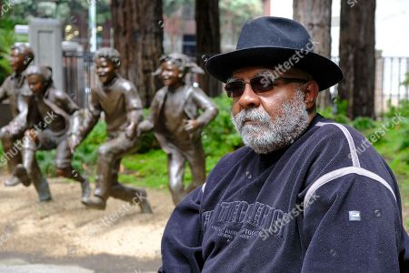 Former Peoples Temple member Eugene Smith poses for a photo in a park in San Francisco. Dozens of Peoples Temple members in Guyana survived the mass suicides and murders of more than 900 because they had slipped out of Jonestown or happened to be away Nov. 18, 1978. Smith recalls how his mother, a churchgoing African-American, bought into Jim Jones' dream when he opened a new church in Fresno. She gave her house to the Peoples Temple and they moved to San Francisco, where Eugene ran a temple construction crew. He was just 14