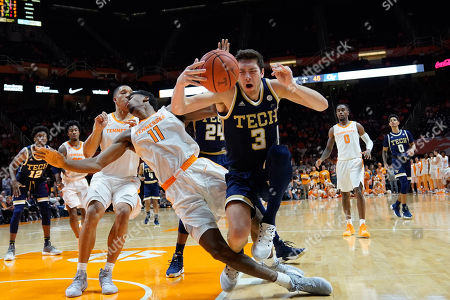 Evan Cole #3 of the Georgia Tech Yellow Jackets charges into Kyle Alexander #11 of the Tennessee Volunteers during the NCAA basketball game between the University of Tennessee Volunteers and the Georgia Tech Yellow Jackets at Thompson Boling Arena in Knoxville TN Tim Gangloff/CSM