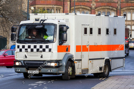 """Stock Photo of A prison van believed to be transporting Charles Bronson from HMP Frankland arrives at Leeds Crown Court this morning. Bronson age 65 """"Britain's most violent prisoner"""" is on trial at Leeds Crown Court charged with attempting to cause grievous bodily harm with intent to HMP Wakefield Governor Mark Docherty on January the 25th. Bronson is defending himself in court & is standing trial under the name Charles Salvador."""