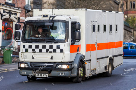 """A prison van believed to be transporting Charles Bronson from HMP Frankland arrives at Leeds Crown Court this morning. Bronson age 65 """"Britain's most violent prisoner"""" is on trial at Leeds Crown Court charged with attempting to cause grievous bodily harm with intent to HMP Wakefield Governor Mark Docherty on January the 25th. Bronson is defending himself in court & is standing trial under the name Charles Salvador."""