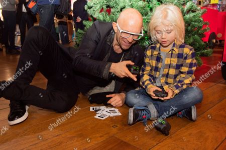 Jason Bradbury from the gadget show playing with Boxer the robot toy with his son