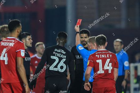 Zeki Fryers (03) of Barnsley receives a red card after a second yellow of referee John Busby