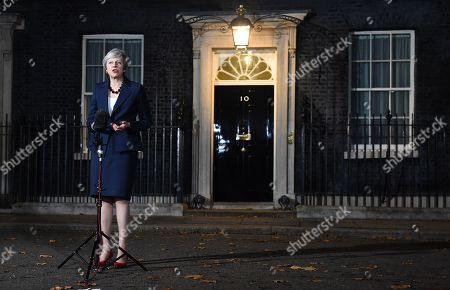 British Prime Minister Theresa May gives a statement outside Downing Street No 10 in London, Britain, 14 November 2018. Theresa May said Cabinet has backed the draft Brexit withdrawal agreement.