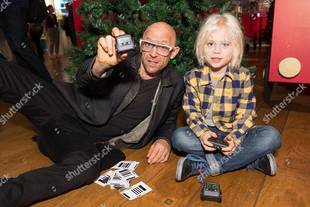 Stock Image of Jason Bradbury from the gadget show playing with Boxer the robot toy with his son