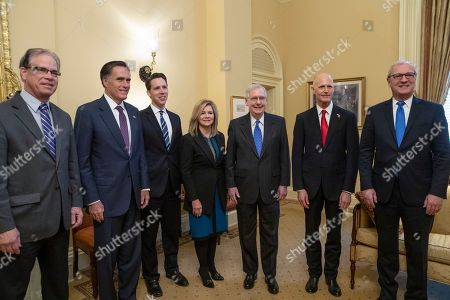 Mike Braun, Mitt Romney, Josh Hawley, Marsha Blackburn, Mitch McConnell, Rick Scott, Kevin Cramer. Senate Majority Leader Mitch McConnell, R-Ky., center, meets with incoming GOP senators for the 116th Congress, at the Capitol in Washington, . From left are, Sen.-elect Mike Braun, R-Ind., Sen.-elect Mitt Romney, R-Utah, Sen.-elect Josh Hawley, R-Mo., Sen.-elect Marsha Blackburn, R-Tenn., Majority Leader Mitch McConnell, R-Ky., Florida Gov. Rick Scott, the Republican candidate in the undecided race for Senate from Florida, and Sen.-elect Kevin Cramer, R-N.D