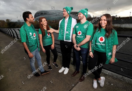 Vodafone, and former Irish rugby international Jamie Heaslip, are calling on Ireland fans to show their support for Irish rugby when they face New Zealand this Saturday and ?Wear Green with the Team Of Us?. Fans travelling to the match are encouraged to pull out their Ireland jersey, green scarf, hats and flags and turn Aviva Stadium green. Fans at home can also get involved by sharing a snap of themselves in green with #TeamOfUs on social to be in with a chance of winning one of 100 new Ireland rugby jerseys. We all belong to the #TeamOfUs. Pictured is Jamie Heaslip with Ireland fans