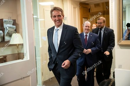 Jeff Flake, Chris Coons. Sen. Jeff Flake, R-Ariz., left, and Sen. Chris Coons, D-Del., arrive to speak to reporters about their effort to bring up legislation to protect special counsel Robert Mueller, at the Capitol in Washington, . Senate Republicans are facing renewed pressure to pass legislation to protect Mueller, with a handful of GOP senators urging their leadership to hold a vote now that President Donald Trump has pushed out Attorney General Jeff Sessions