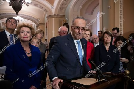 Joe Manchin, Debbie Stabenow, Patty Murray, Tammy Baldwin, Bernie Sanders, Chuck Schumer, Elizabeth Warren, Amy Klobuchar. Senate Minority Leader Chuck Schumer, D-N.Y., is surrounded by the Senate Democratic Caucus as he talks to reporters at the Capitol in Washington, . From left are, Sen. Joe Manchin, D-W.Va., Sen. Debbie Stabenow, D-Mich., Sen. Patty Murray, D-Wash., Sen. Tammy Baldwin, D-Wis., Sen. Bernie Sanders, I-Vt., Chuck Schumer, Sen. Elizabeth Warren, D-Mass., and Sen. Amy Klobuchar, D-Minn