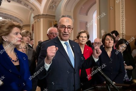Debbie Stabenow, Patty Murray, Tammy Baldwin, Bernie Sanders, Chuck Schumer, Elizabeth Warren, Amy Klobuchar. Senate Minority Leader Chuck Schumer, D-N.Y., is surrounded by the Senate Democratic Caucus as he talks to reporters at the Capitol in Washington, . From left are, Sen. Debbie Stabenow, D-Mich., Sen. Patty Murray, D-Wash., Sen. Tammy Baldwin, D-Wis., Sen. Bernie Sanders, I-Vt., Chuck Schumer, Sen. Elizabeth Warren, D-Mass., and Sen. Amy Klobuchar, D-Minn