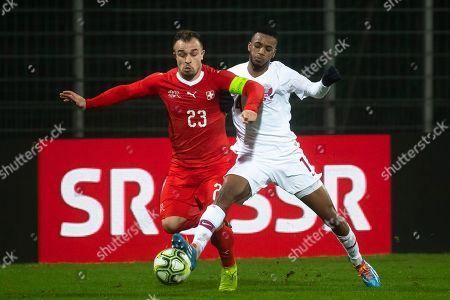 Switzerland's Xherdan Shaqiri (L) in action against Qatar's Ahmed Fathi (R) during the International Friendly soccer match between Switzerland and Qatar in Lugano, Switzerland, 14 November 2018.