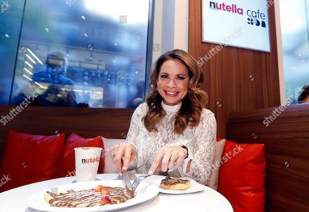 Carolina Bermudez, talk show host on New York's KTU radio station, enjoys tasty dishes at the grand opening of the Nutella Cafe New York, in New York. Located at 13th Street and University Place near Union Square, Nutella Cafe New York is the second Nutella restaurant owned and operated by Ferrero in the U.S
