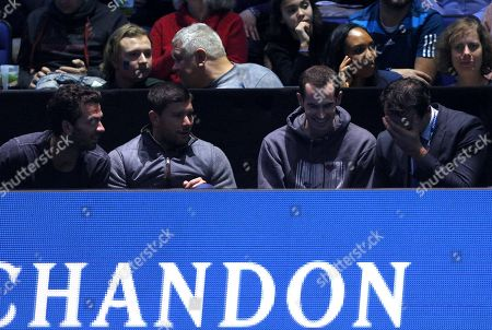 Stock Image of Andy Murray of Great Britain watches the action court side with Ross Hutchins, Dani Vallverdu and Jean-Julien Rojer, laughing