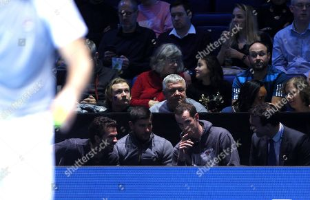 Andy Murray of Great Britain watches the action court side with Ross Hutchins, Dani Vallverdu and Jean-Julien Rojer