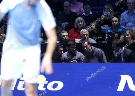Stock Photo of Andy Murray of Great Britain watches the action court side with Ross Hutchins, Dani Vallverdu and Jean-Julien Rojer