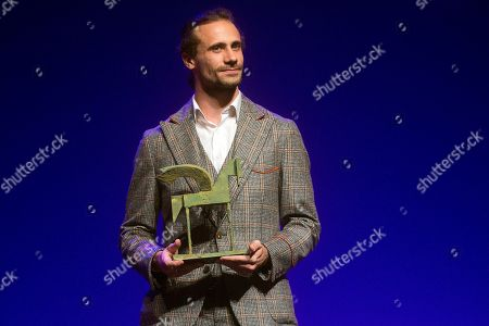 Stock Image of Spanish actor Oriol Pla poses after receiving the Best Male Performance award during the Onda Award ceremony in Barcelona, Spain, 14 November 2018.