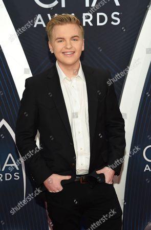 Caleb Lee Hutchinson arrives at the 52nd annual CMA Awards at Bridgestone Arena, in Nashville, Tenn